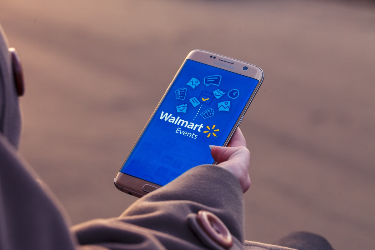 Woman looking at Walmart site on phone