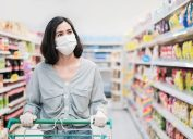 woman shopping while wearing a mask