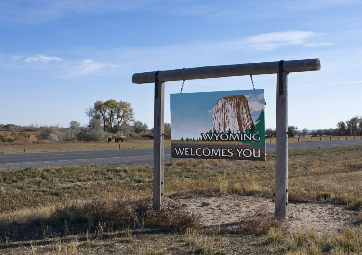 """a """"Wyoming Welcomes You"""" sign off of a highway"""