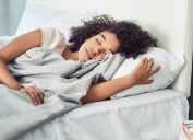 A young woman sleeping peacefully in her bed