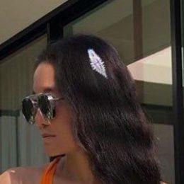 crop of vera wang vial photo focusing on her hair