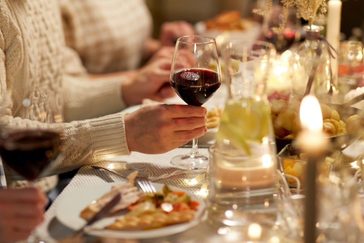 People drinking red wine with Thanksgiving dinner