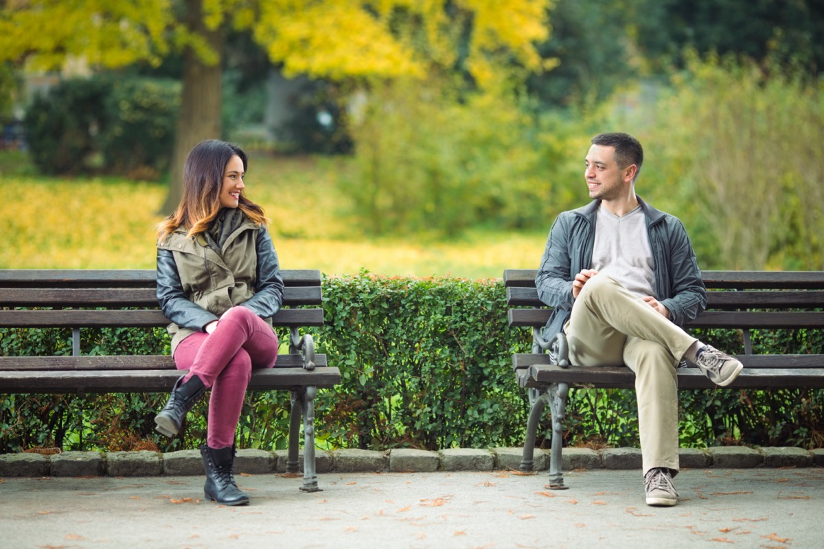 Young man and woman meeting in park