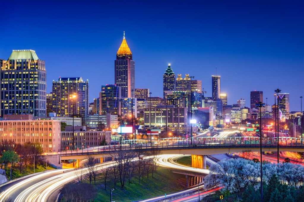 cityscape photo of fast moving traffic on a highway and building in Atlanta, Georgia at night