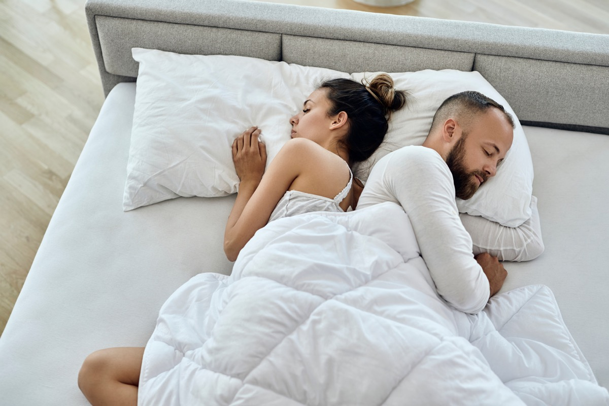 Back-to-back touch couple sleeping position