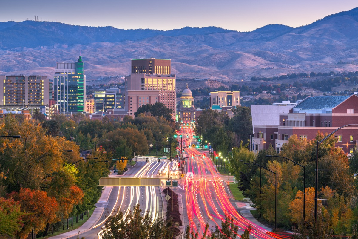 cityscape photos of mountains, moving cars, buildings, and the state capitol in Boise, Idaho at sunset