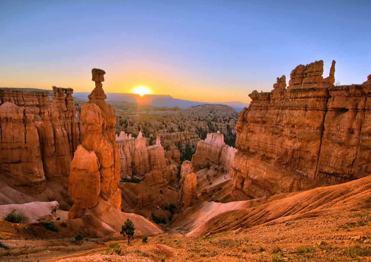 orange rocks and mountains in Bryce Canyon National Park, Utah at sunrise