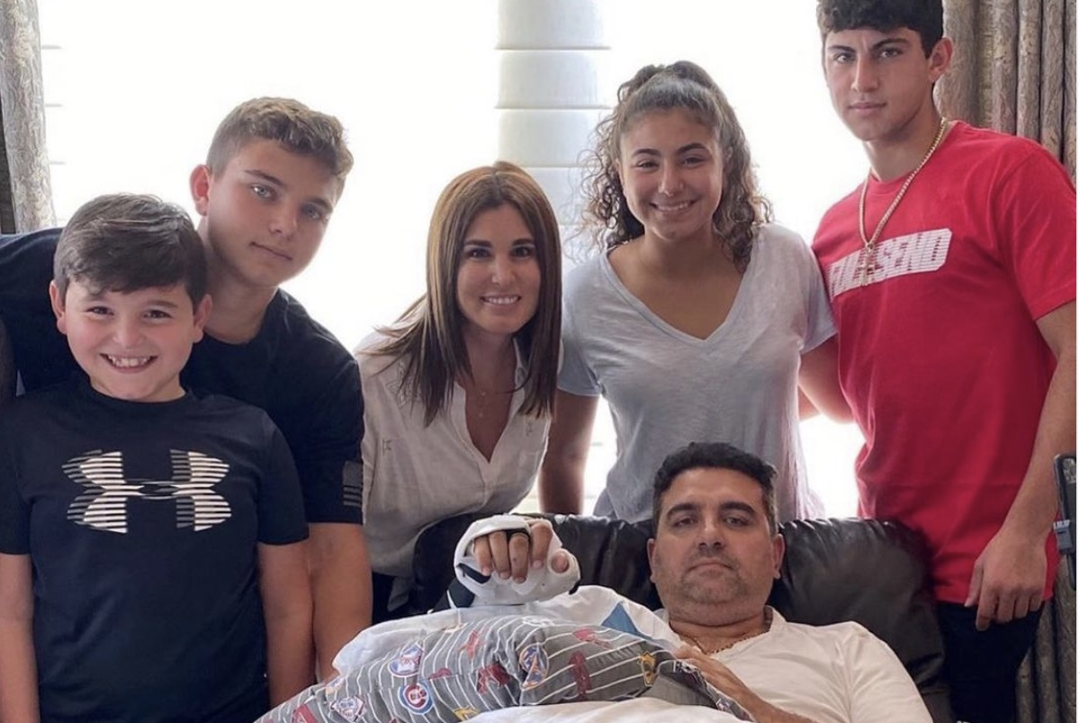 Buddy Valastro surrounded by his family after hand injury