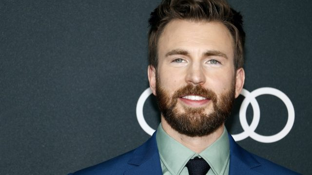 """Chris Evans wears a blue suit at the world premiere of """"Avengers: Endgame"""" in 2019"""