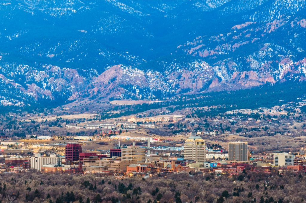 skyline and mountains in Colorado Springs, Colorado at dusk