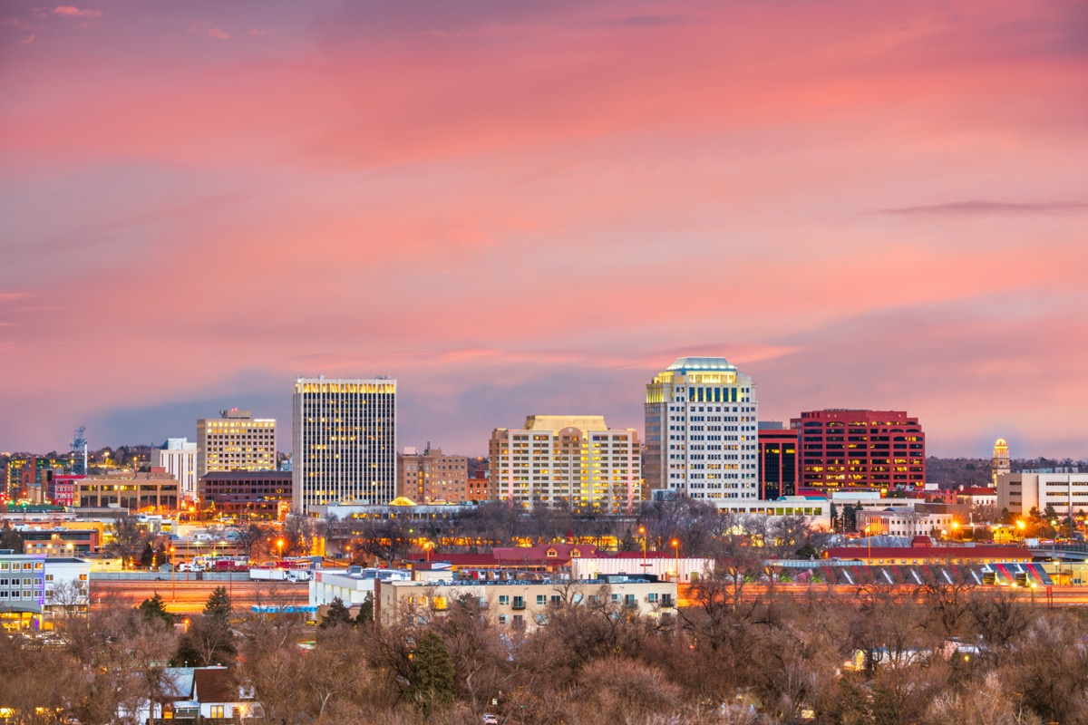 cityscape photo of buildings and tress in Colorado Springs, Colorado at sunset