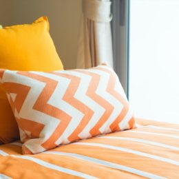 bed with colorful yellow bedding
