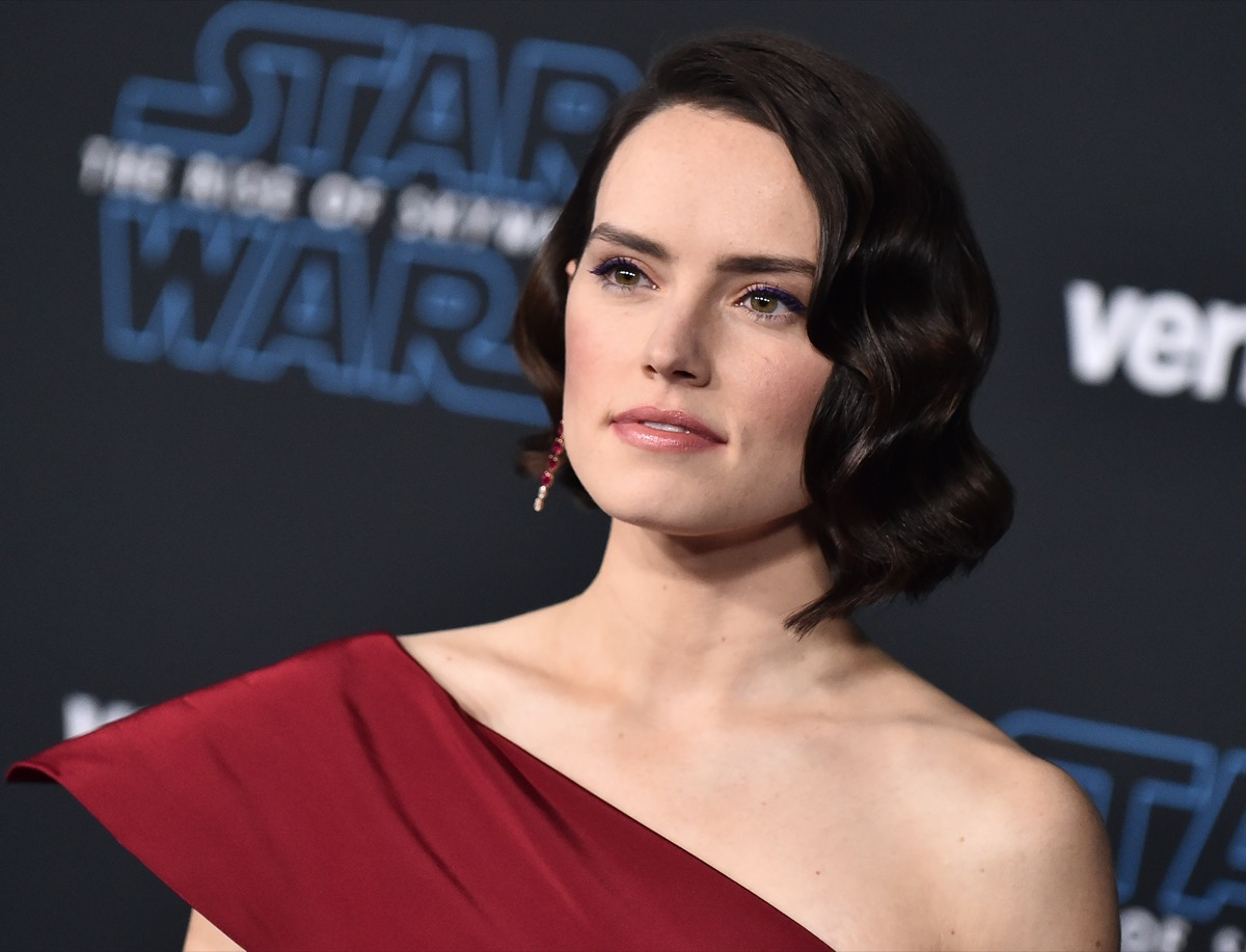 """Daisy Ridley wears a red dress as the premiere of """"Star Wars: The Rise of Skywalker"""" in 2019"""