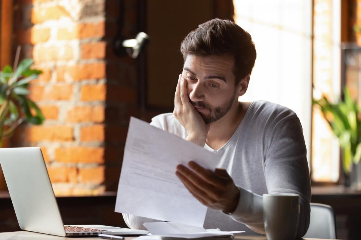 Man looking at debt