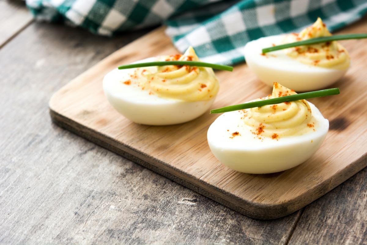 deviled eggs on cutting board