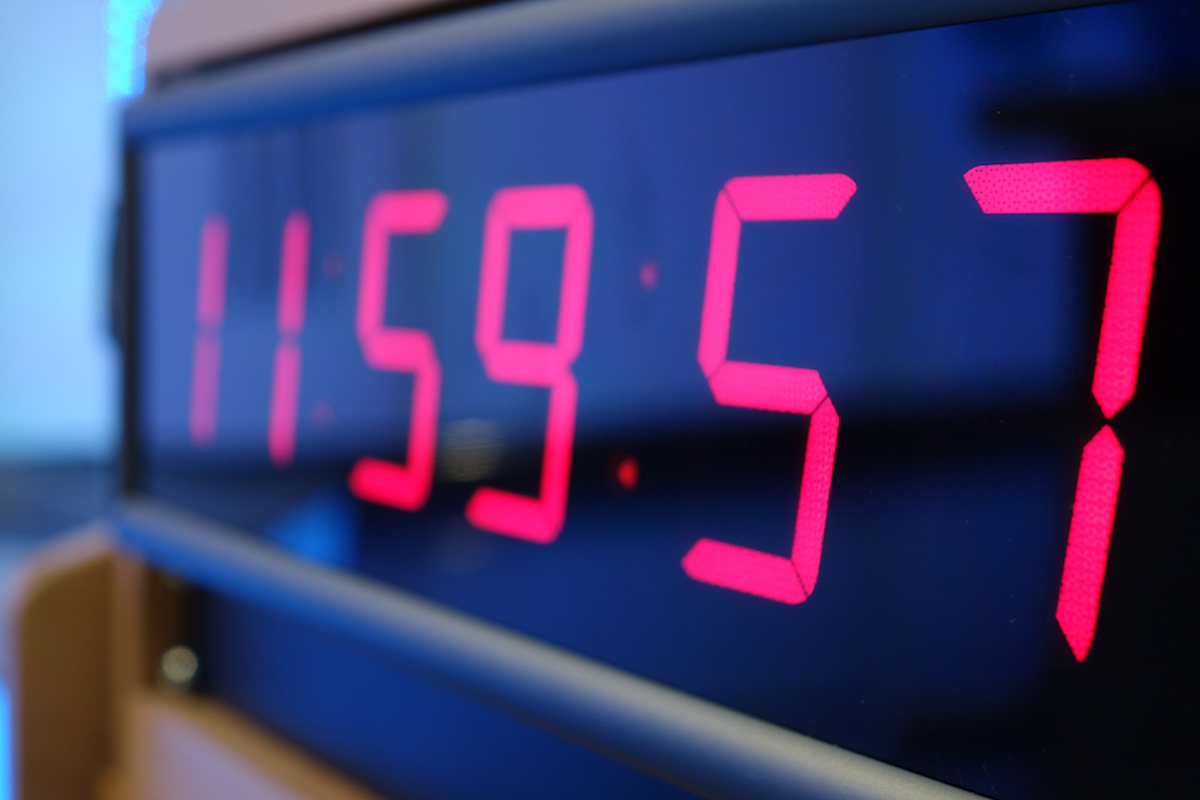 closeup of digital timer, black with red numbers