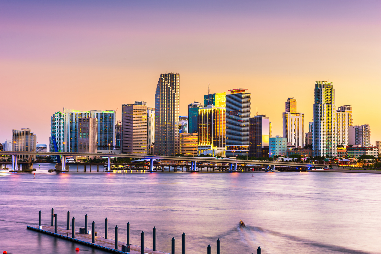 The skyline of Miami, Florida from the water at sunset