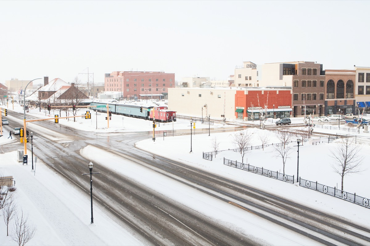 empty street and buildings in downtown Fargo, North Dakota during a snow storm