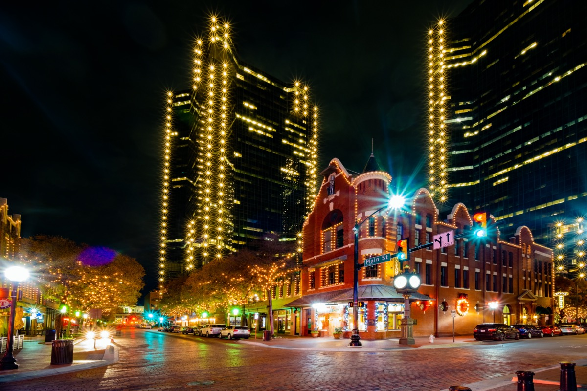 cityscape photo of Main Street and the downtown Fort Worth, Texas at night