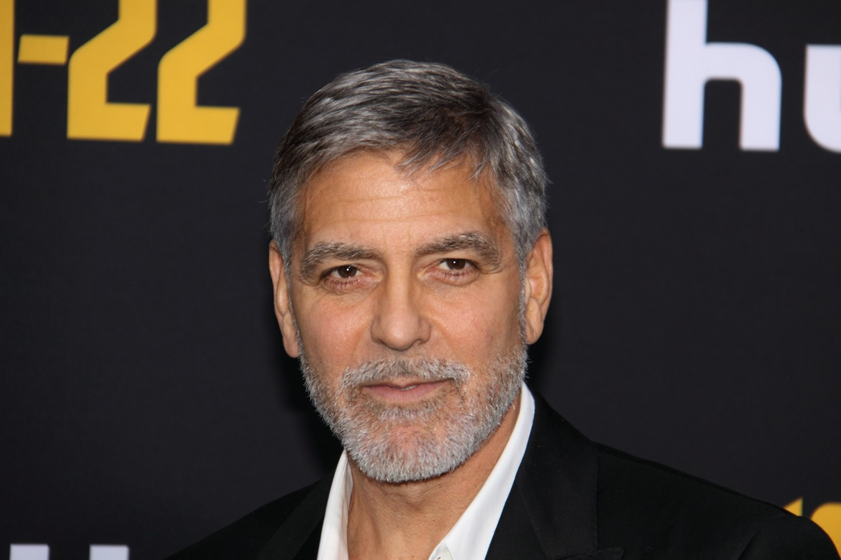 """George Clooney wears a black suit at the premiere of """"Catch-22"""" in 2019"""