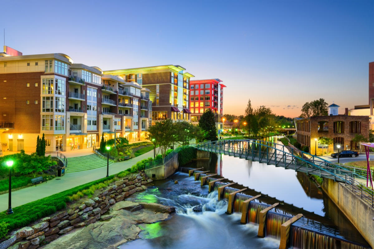 cityscape photos of bridge, lake, and apartment buildings in Greenville, South Carolina at dusk