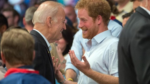 Prince Harry of Wales and Vice President Joe Biden bump into each other in the stands of a wheelchair rugby match during the 2016 Invictus Games at the ESPN Wide World of Sports Complex May 11, 2016 in Orlando, Florida