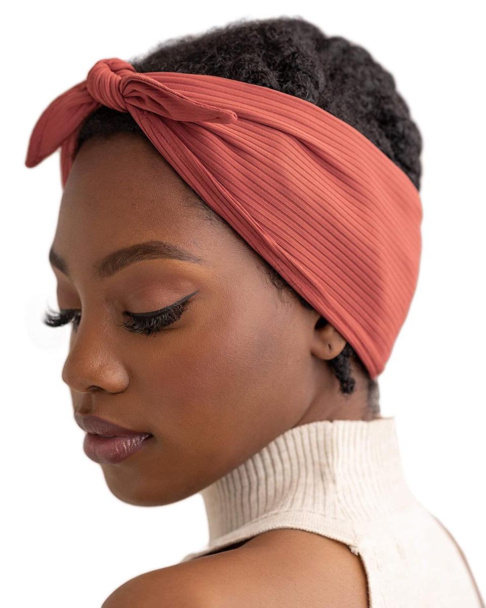 young black woman in orange hair wrap
