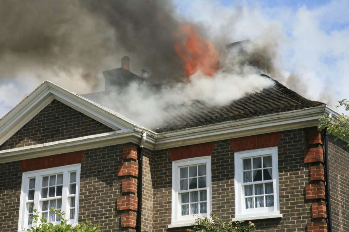 house with roof on fire