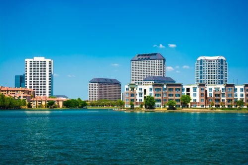 city skyline of Irving, Texas with Lake Carolyn in the foreground