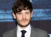 Actor Iwan Rheon on the red carpet at a Game of Thrones premiere.