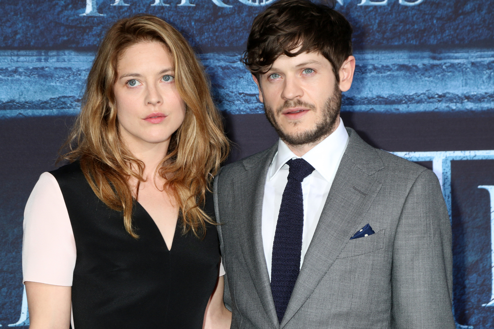 Actor Iwan Rheon stands with Zoe Grisedale on the red carpet