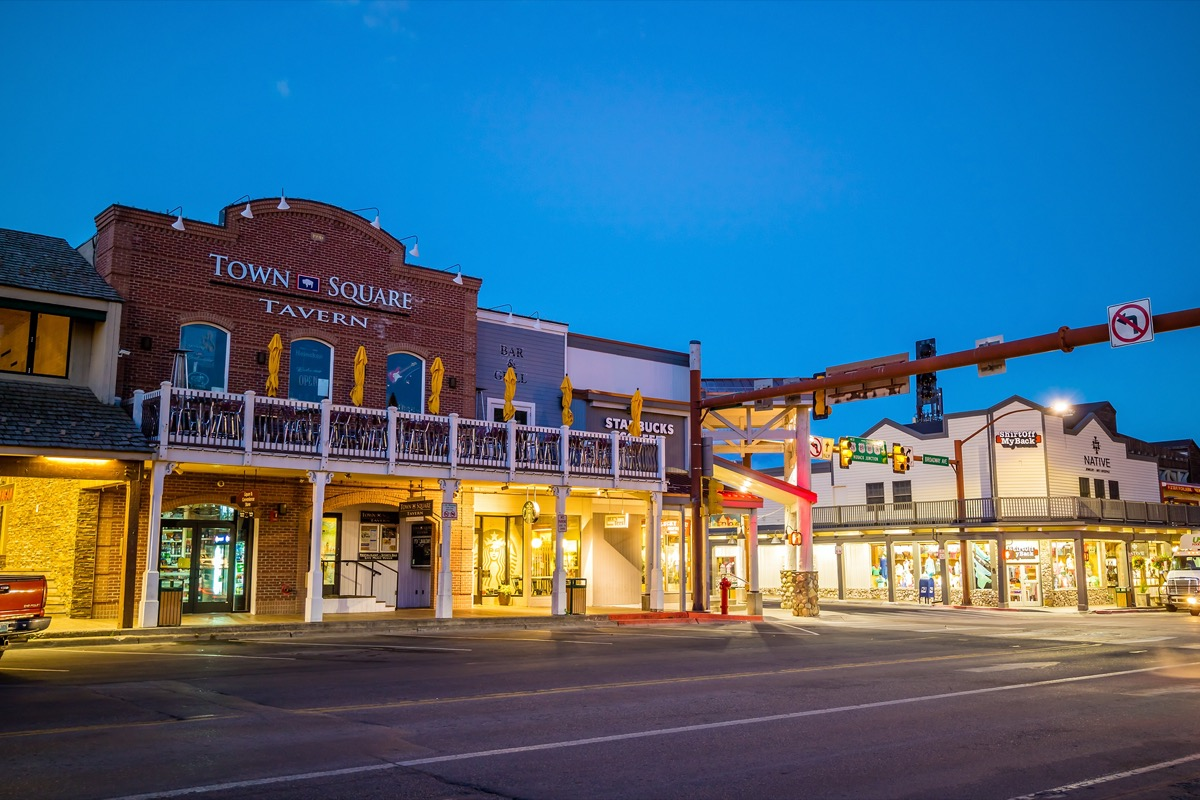 cityscape photos of stores and empty street in downtown Jackson Hole, Wyoming at night