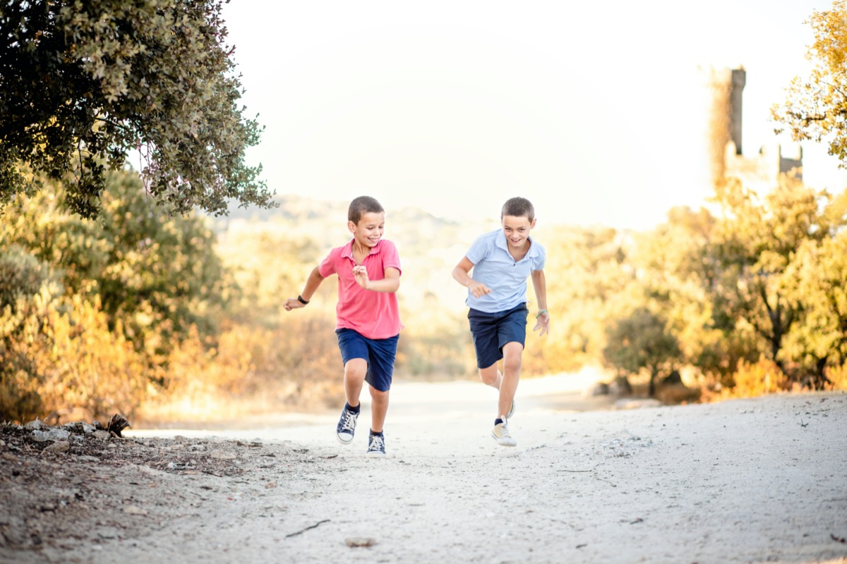 two brothers running into nature
