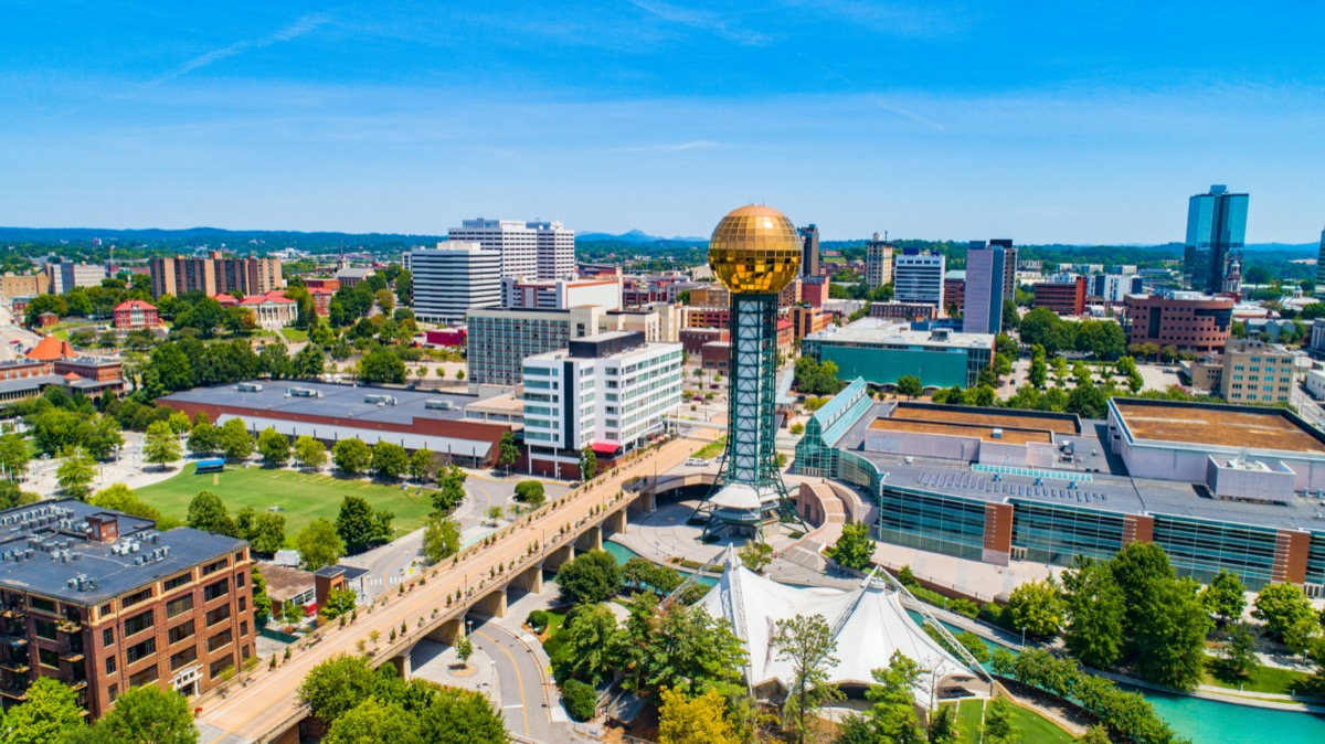 cityscape photo of buildings, a highway, and the Sunsphere in Knoxville, Tennessee