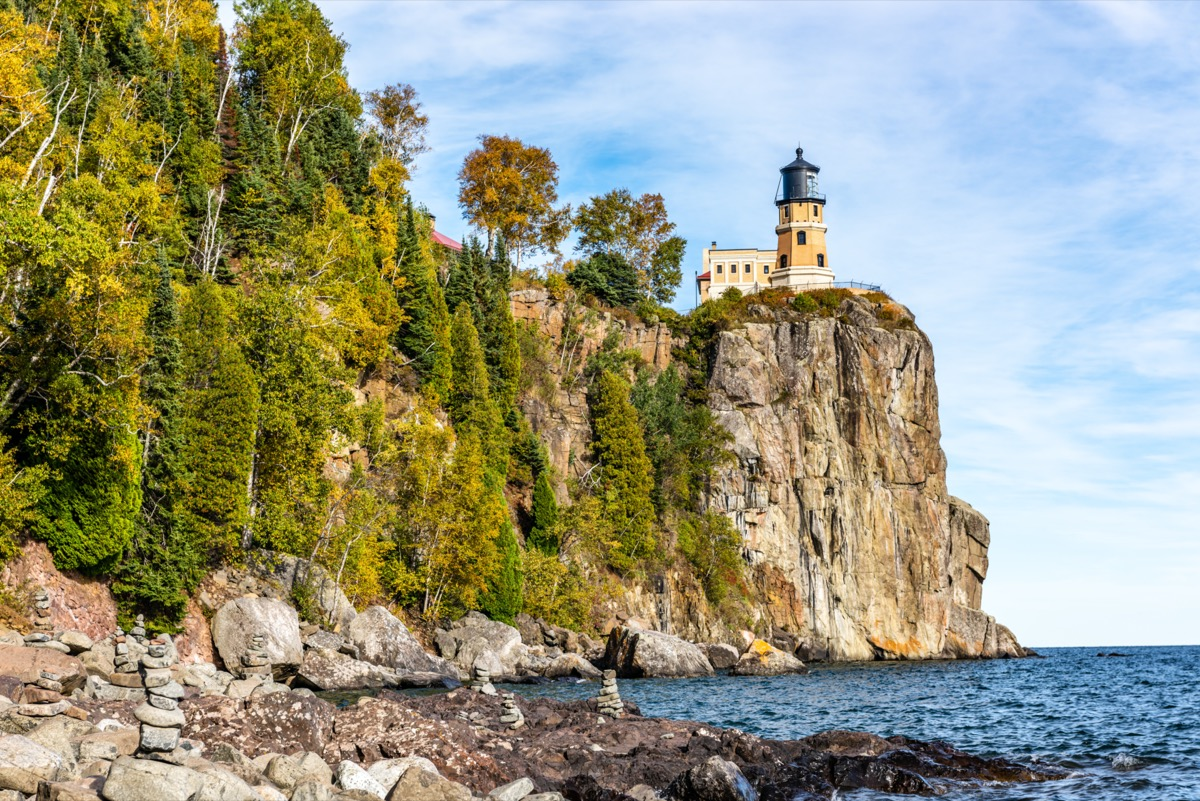 landscape photo of rocks, ocean, and lighthouse in Lake County, Minnesota