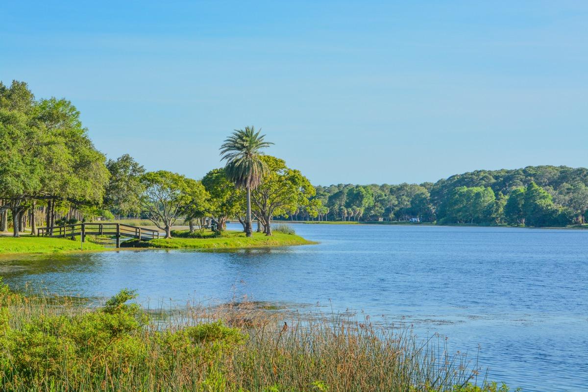 wooden bridge and lake at John S. Taylor Park in Largo, Florida