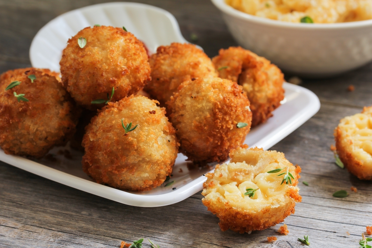 Fried Mac and Cheese balls served on white platter