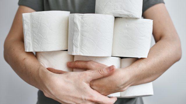 white man holding toilet paper