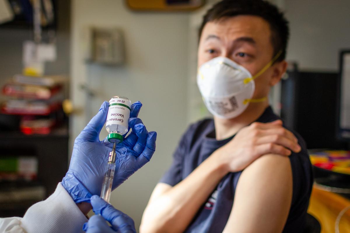 male getting vaccinated against coronavirus