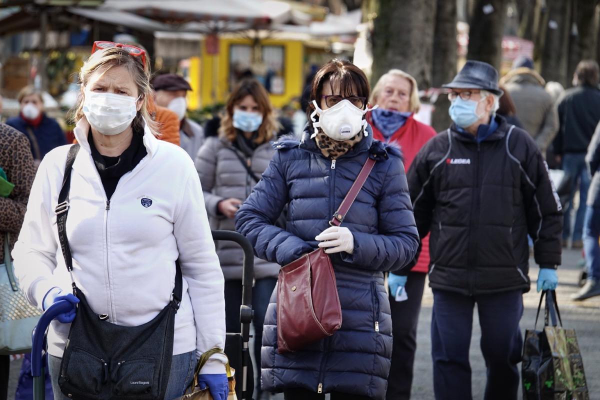 People wearing masks in street