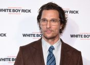 matthew mcconaughey in brown suit in front of step and repeat