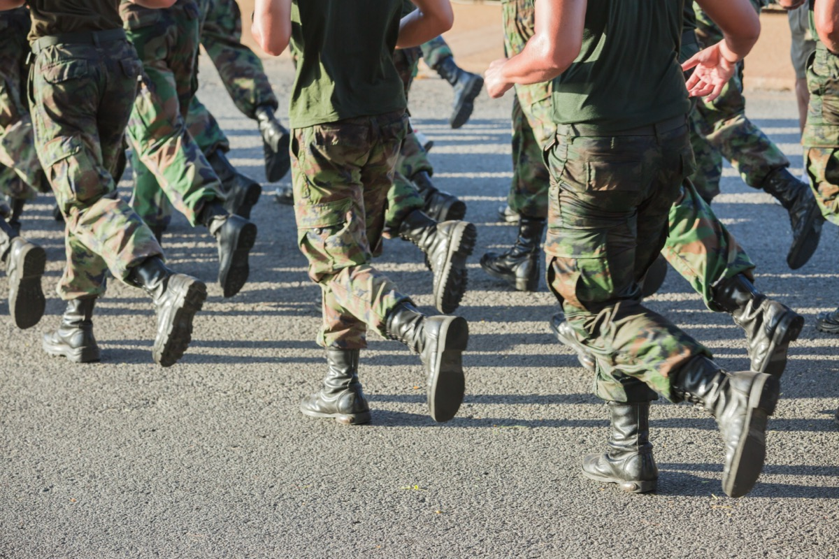 legs of military men running