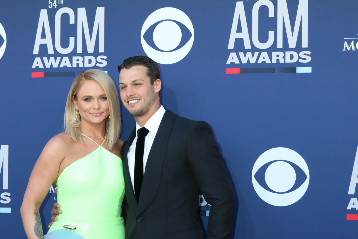 Mirand Lambert wears a green dress and Brendan McLoughlin wears a suit at the 54th Academy of Country Music Awards in 2019