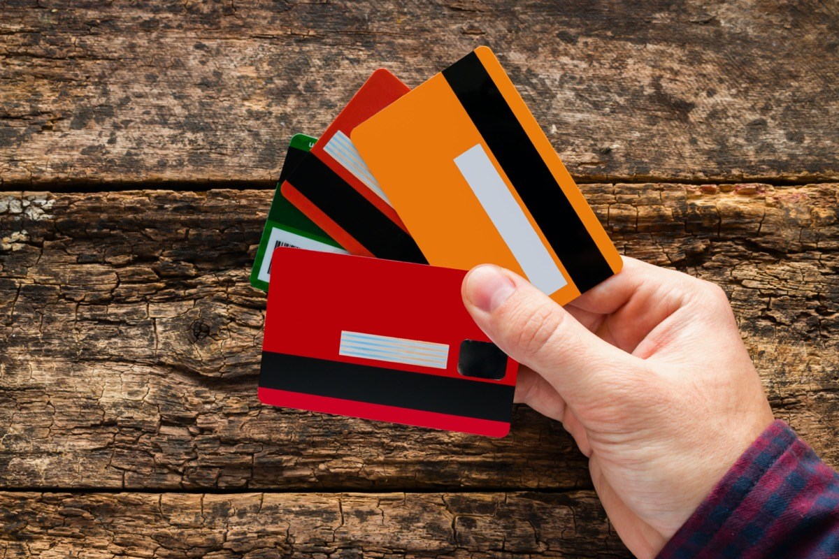 multiple credit cards in one hand