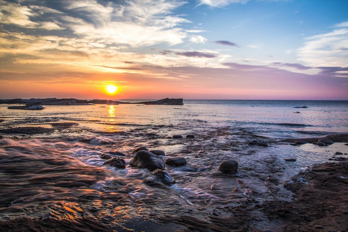 ocean and rocks in Munising, Michigan at dusk