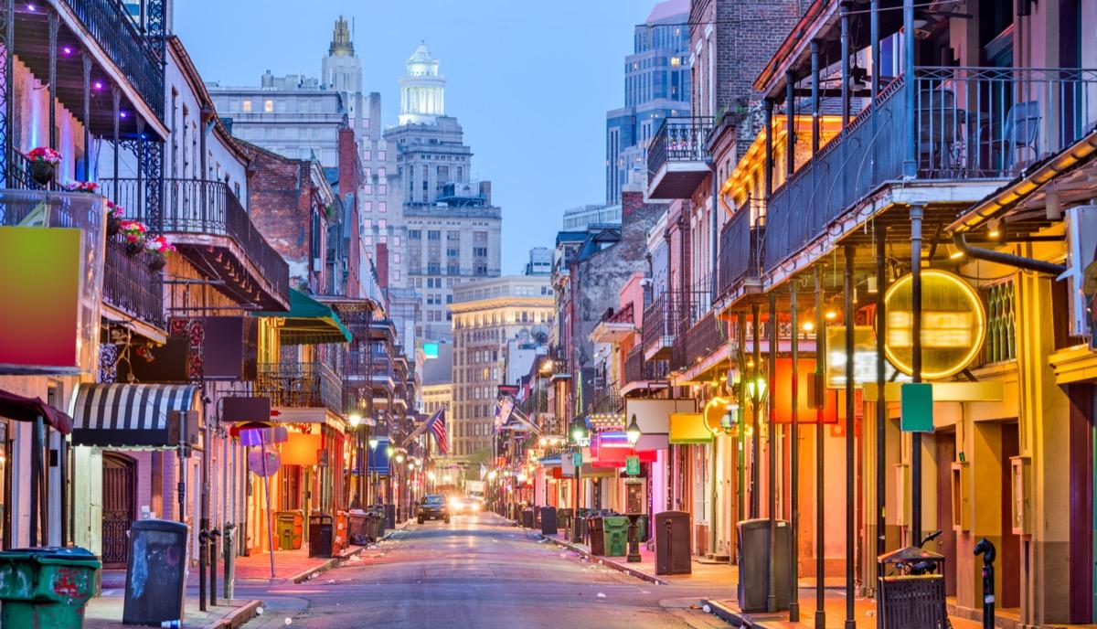 cityscape photos of bars and restaurants on Bourbon Street in New Orleans, Louisiana at twilight