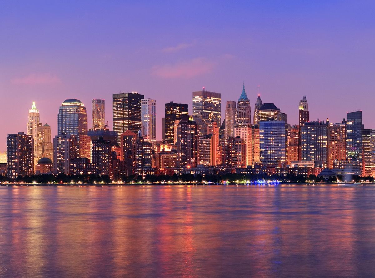 city skyline and skyscrapers along the Hudson River in New York, New York at sunset