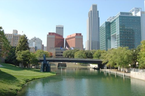 lake, bridge, and buildings in the downtown Omaha, Nebraska