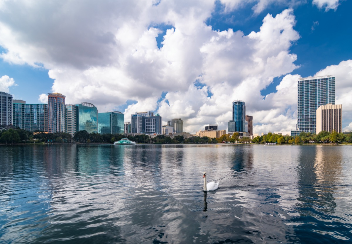 Lake Eola Park in and city skyline of downtown Orlando, Flordia