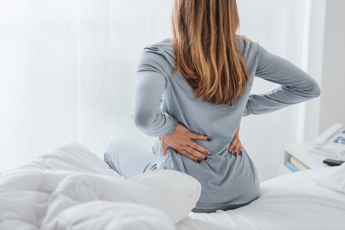 Woman with back pain from sleeping on her stomach